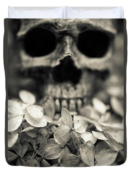 Duvet Cover featuring the photograph Human Skull Among Flowers by Edward Fielding