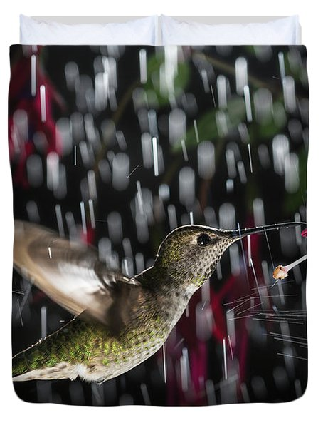 Duvet Cover featuring the photograph Hummingbird Hovering In Rain With Splash by William Lee