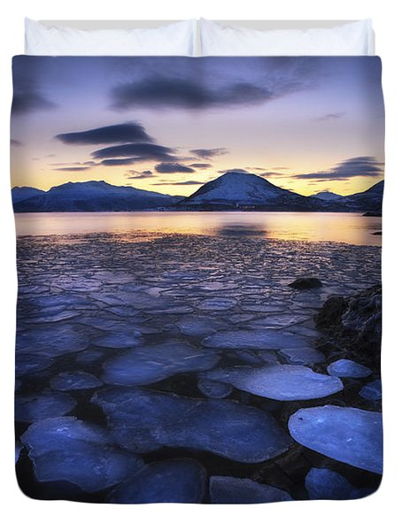Ice Flakes Drifting Against The Sunset Duvet Cover by Arild Heitmann