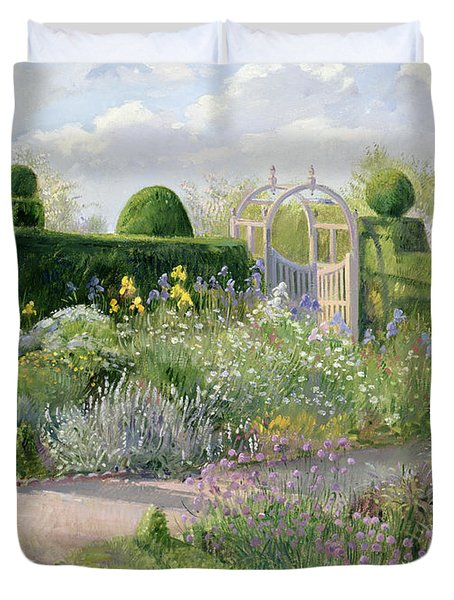 Irises In The Herb Garden Duvet Cover