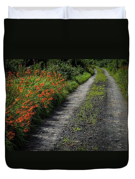 Duvet Cover featuring the photograph Irish Country Road Lined With Wildflowers by James Truett