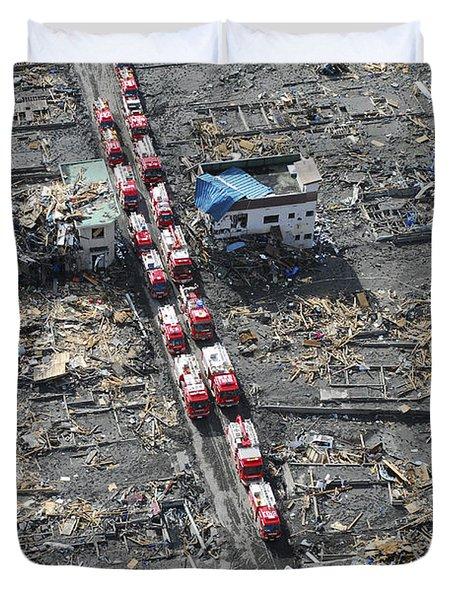 Japanese Fire Trucks Line A Road Duvet Cover by Stocktrek Images