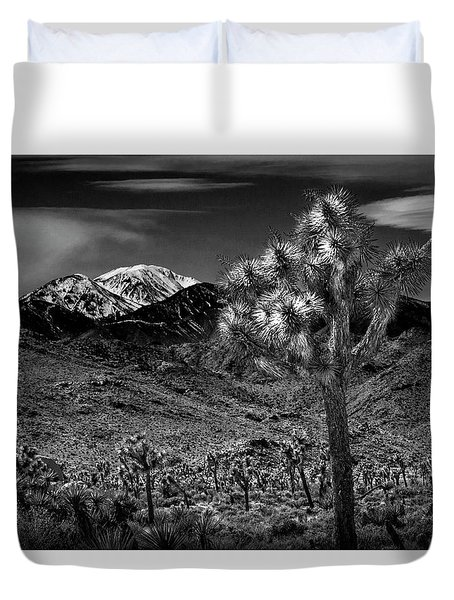 Duvet Cover featuring the photograph Joshua Tree In Black And White In Joshua Park National Park With The Little San Bernardino Mountains by Randall Nyhof