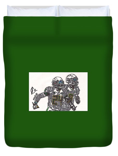 Kenjon Barner And Marcus Mariota Duvet Cover by Jeremiah Colley