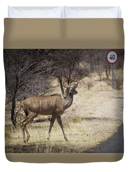 Duvet Cover featuring the photograph Kudu Crossing by Ernie Echols