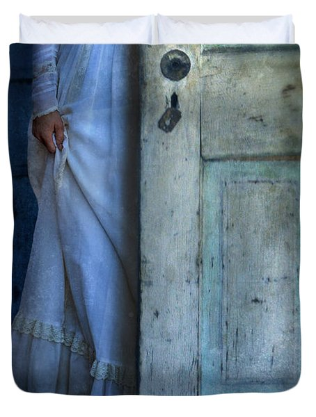 Lady In Vintage Clothing Hiding Behind Old Door Duvet Cover by Jill Battaglia