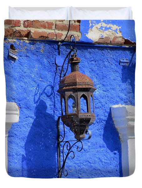 Lantern On Blue Wall Duvet Cover by Randall Weidner
