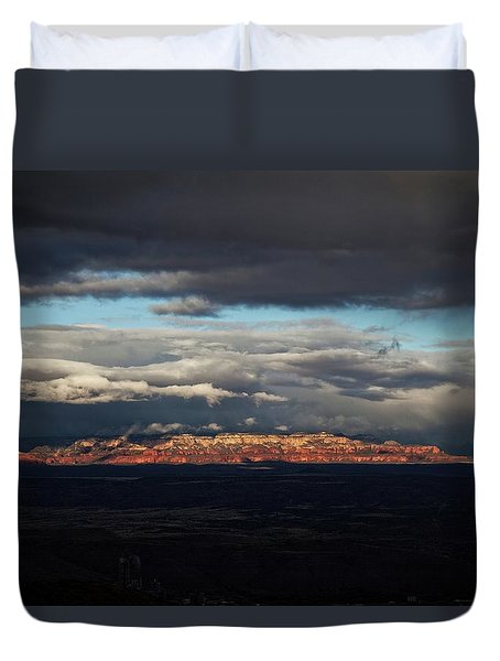 Duvet Cover featuring the photograph Late Light On Red Rocks With Storm Clouds by Ron Chilston