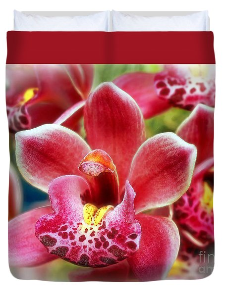 Laughing Orchids Duvet Cover by Sue Melvin