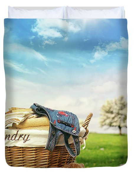 Laundry Basket With Clothes Against A Blue Sky Duvet Cover