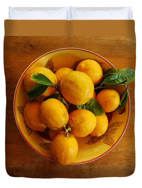 Duvet Cover featuring the photograph Lemons In Bowl by Jocelyn Friis