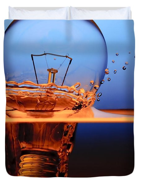 Duvet Cover featuring the photograph Light Bulb And Splash Water by Setsiri Silapasuwanchai