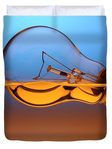Light Bulb In Water Duvet Cover by Setsiri Silapasuwanchai