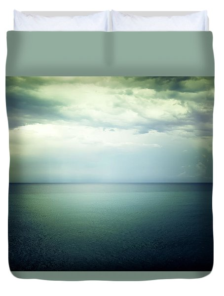 Light In The Sky Above The Dark Gloomy Sea Duvet Cover