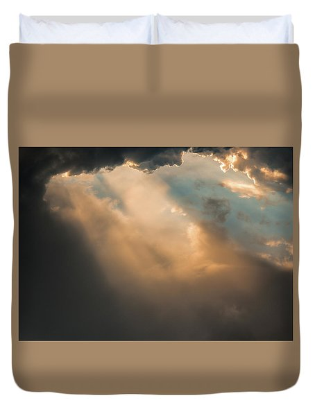 Light Punches Through Darkness Duvet Cover