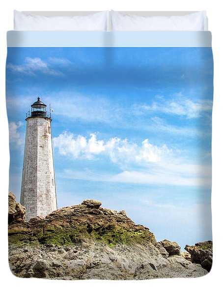 Duvet Cover featuring the photograph Lighthouse And Rocks by Dawn Romine