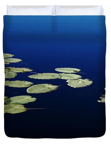 Duvet Cover featuring the photograph Lily Pads Floating On River by Debbie Oppermann