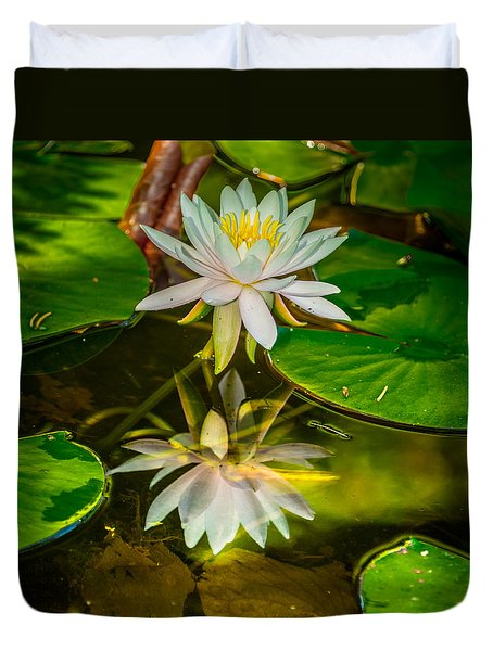 Duvet Cover featuring the photograph Lily Reflection by Jerry Cahill