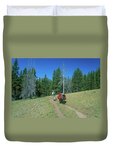 Lone Llama Packer In The Beautiful Bob Marshall Wilderness Duvet Cover by Jerry Voss