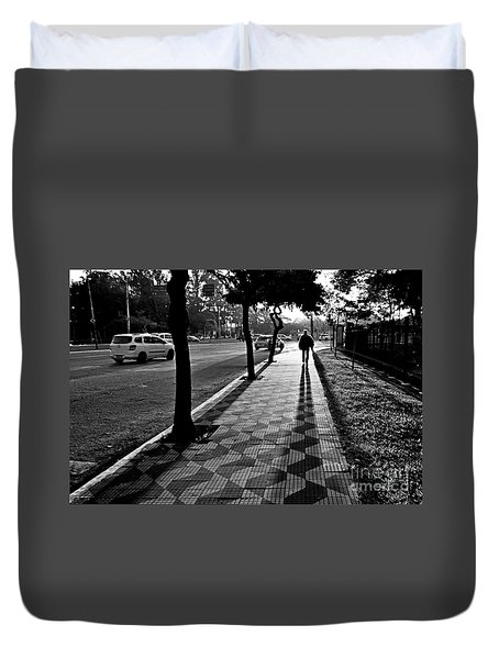 Lonely Man Walking At Dusk In Sao Paulo Duvet Cover