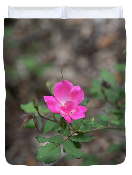 Duvet Cover featuring the photograph Lonely Pink Flower by Raphael Lopez