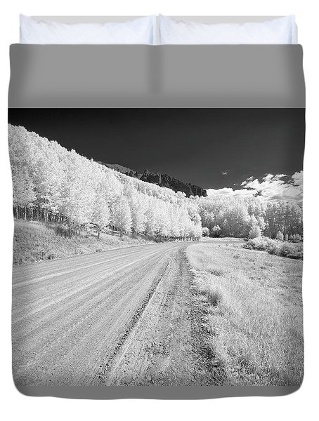 Duvet Cover featuring the photograph Long Road In Colorado by Jon Glaser