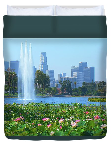 Duvet Cover featuring the photograph Lotus Blooms In Echo Park And Los Angeles Skyline by Ram Vasudev