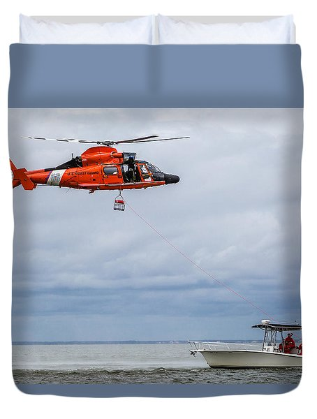 Duvet Cover featuring the photograph Lowering Rescue Basket by Gregory Daley  PPSA
