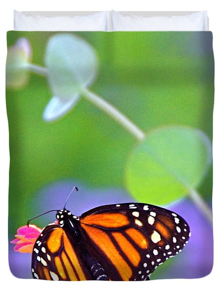 Duvet Cover featuring the photograph Magical Monarch by Byron Varvarigos