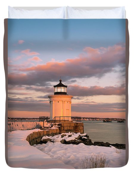 Duvet Cover featuring the photograph Maine Bug Light Lighthouse Snow At Sunset by Ranjay Mitra