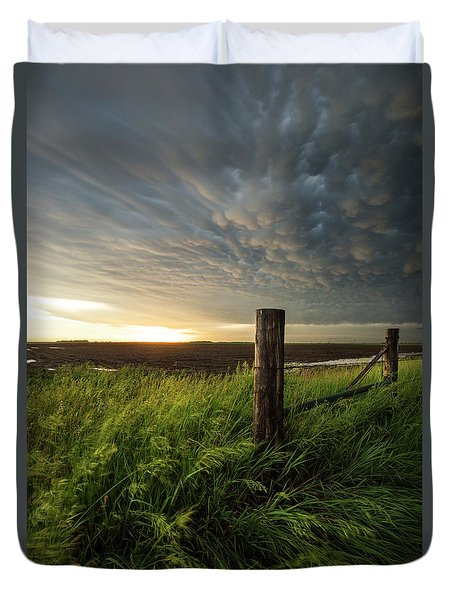 Duvet Cover featuring the photograph Mammatus Sunset by Aaron J Groen