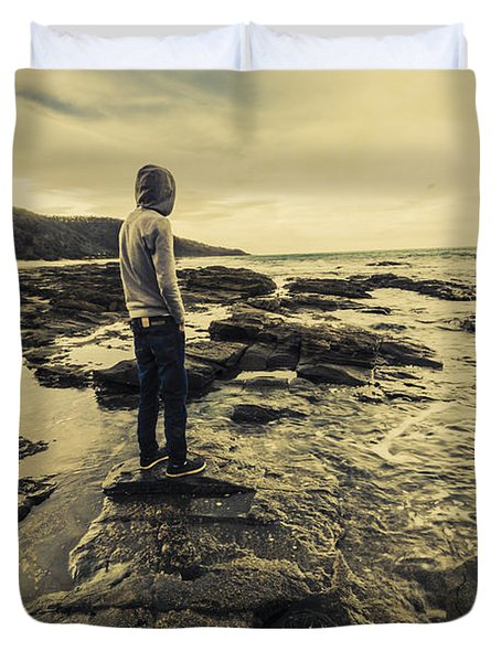 Man Gazing Out On Coastal Rocks Duvet Cover