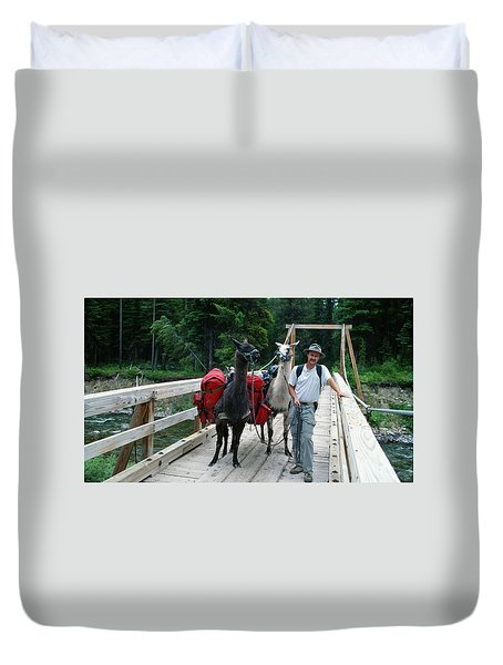 Man Posing With Two Llamas On Wilderness Drawbridge Duvet Cover by Jerry Voss