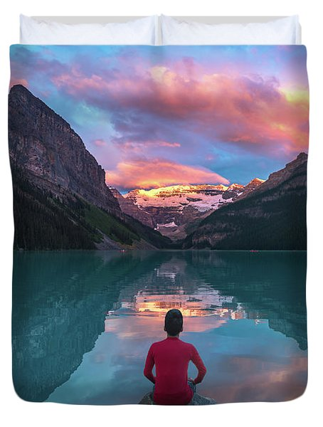 Duvet Cover featuring the photograph Man Sit On Rock Watching Lake Louise Morning Clouds With Reflect by William Lee