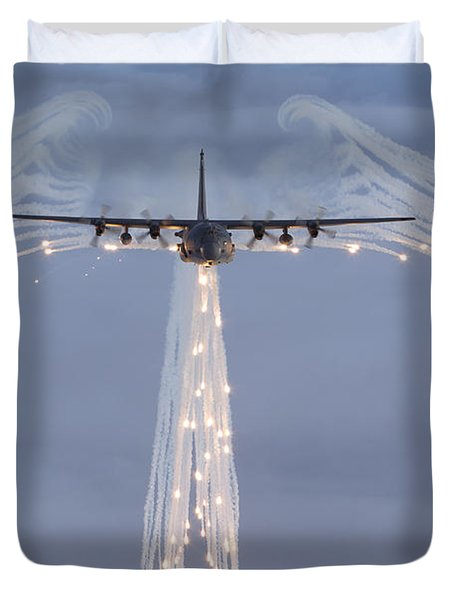 Duvet Cover featuring the photograph Mc-130h Combat Talon Dropping Flares by Gert Kromhout
