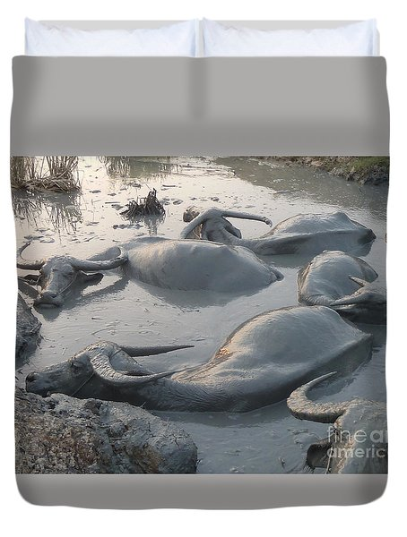 Duvet Cover featuring the photograph Medium Shot Of A Group Of Water Buffalos Wallowing In A Mud Hole by Jason Rosette