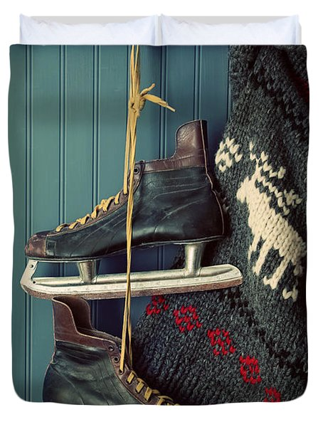 Men's Vintage Skates  And Sweater Hanging On Hooks Duvet Cover