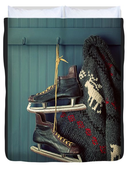 Men's Vintage Skates  And Sweater Hanging On Hooks Duvet Cover