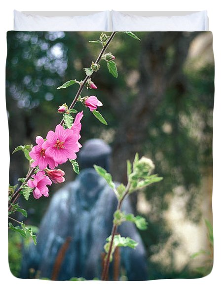 Mission Statue And Flower Duvet Cover by Kathy Yates
