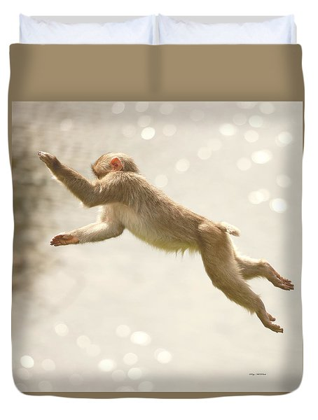 Duvet Cover featuring the photograph Monkey Jump by Roy  McPeak