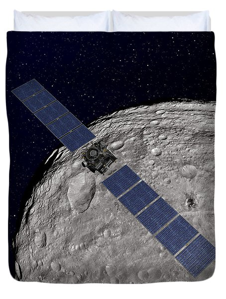 Nasas Dawn Spacecraft Orbiting Duvet Cover by Stocktrek Images