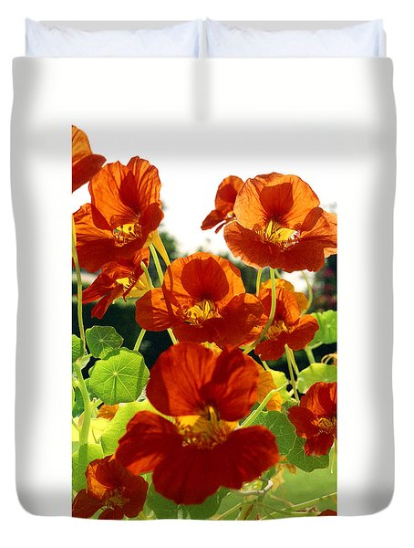 Duvet Cover featuring the photograph Nasturtiums by Emanuel Tanjala