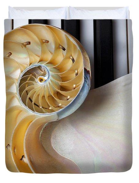 Nautilus Shell On Piano Keys Duvet Cover