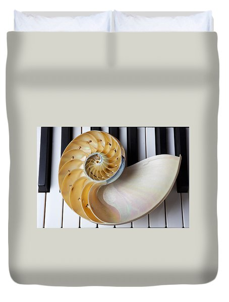 Nautilus Shell On Piano Keys Duvet Cover by Garry Gay