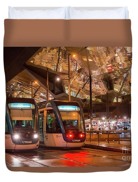 Night View Of Two Trams At Glories Station  Duvet Cover