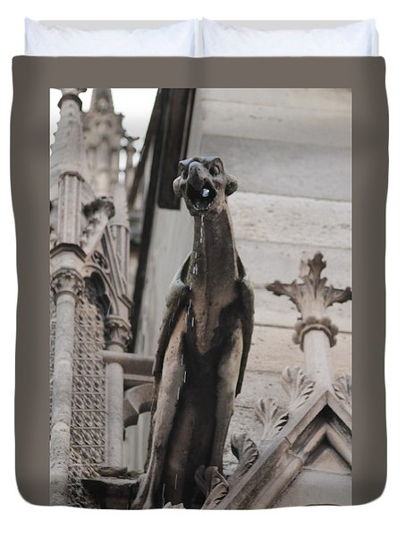 Duvet Cover featuring the photograph Rain Spouting Gargoyle. by Christopher Kirby