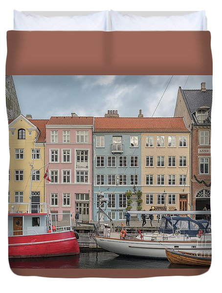 Duvet Cover featuring the photograph Nyhavn Waterfront In Copenhagen by Antony McAulay