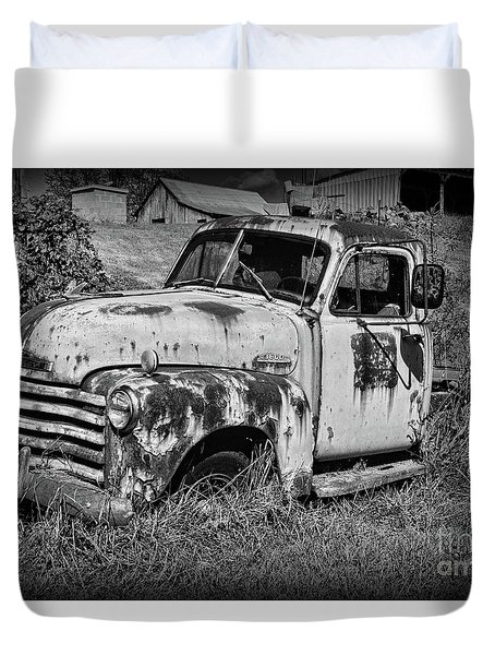 Old Rusty Chevy In Black And White Duvet Cover by Paul Ward