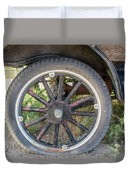 Old Truck Tire In Rural Rocky Mountain Town Duvet Cover