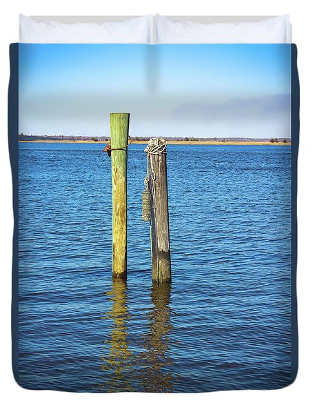 Duvet Cover featuring the photograph Old Wood Pilings In Blue Water by Colleen Kammerer